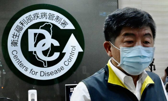 Taiwan's Health and Welfare Minister Chen Shih-chung walks past a logo for the Taiwan Centers for Disease Control (CDC) ahead of the arrival of President Tsai Ing-wen in Taipei on May 19, 2020. (Sam Yeh/AFP via Getty Images)