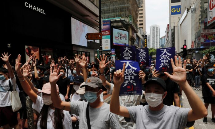 Protesters march against Beijing's plans to impose national security legislation in Hong Kong on May 24, 2020. (Reuters/Tyrone Siu)
