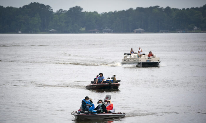 People boat on Lake Tillery near Lilly's Bridge Marina in Mount Gilead, N.C., on Memorial Day May 25, 2020. (Al Drago/Getty Images)