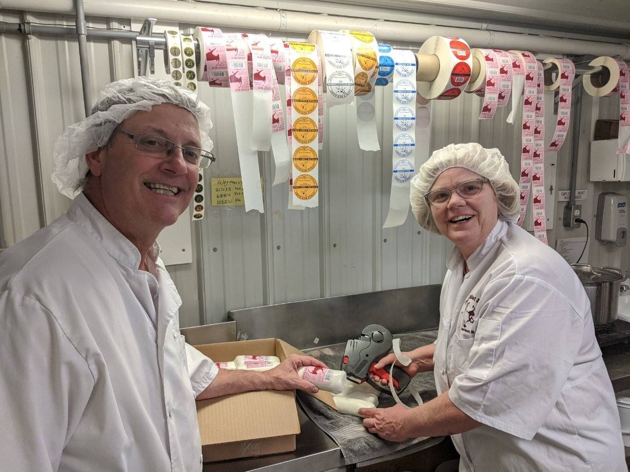 Steve and Susanne Messmer packaging cheese donations
