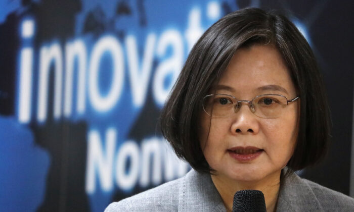 Taiwanese President Tsai Ing-wen speaks at a non-woven filter fabric factory, where the fabric is used to make surgical masks, in Taoyuan, Taiwan, March 30, 2020. (Ann Wang/Reuters)