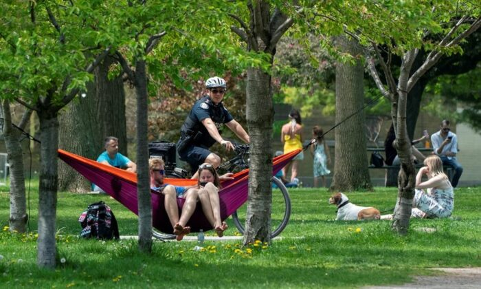 A bicycle police officer patrols Trinity Bellwoods Park in Toronto on May 24, 2020. (The Canadian Press/Frank Gunn)