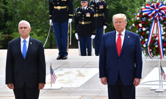 President Donald Trump(R) and Vice President Mike Pence participate in a Wreath Laying Ceremony at the Tomb of the Unknown Soldier at Arlington National Cemetery to commemorate Memorial Day in Arlington, Va., on May 25, 2020. (Nicholas Kamm/AFP via Getty Images)
