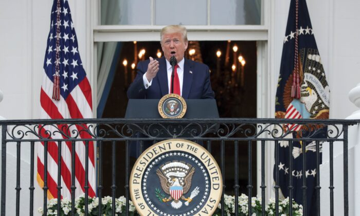 President Donald Trump speaks from the Truman Balcony during a Rolling to Remember Ceremony: Honoring Our Nation's Veterans and POW/MIA at the White House on May 22, 2020. (Alex Wong/Getty Images)