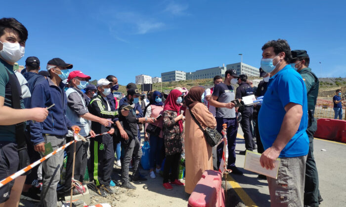 Moroccan citizens wait for repatriation after being stranded in Spain due to the coronavirus pandemic in the Spanish enclave of Ceuta, Spain on May 22, 2020. (Faro de Ceuta via AP)