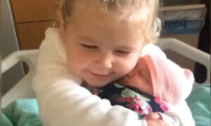 Video: Toddler Falls in Love With Baby Sister on Meeting Her for the First Time