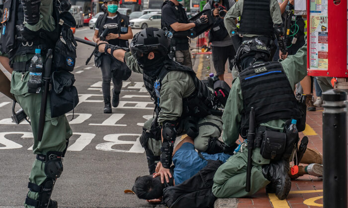A pro-democracy supporter is detained by riot police in Hong Kong on May 24, 2020. (Anthony Kwan/Getty Images)
