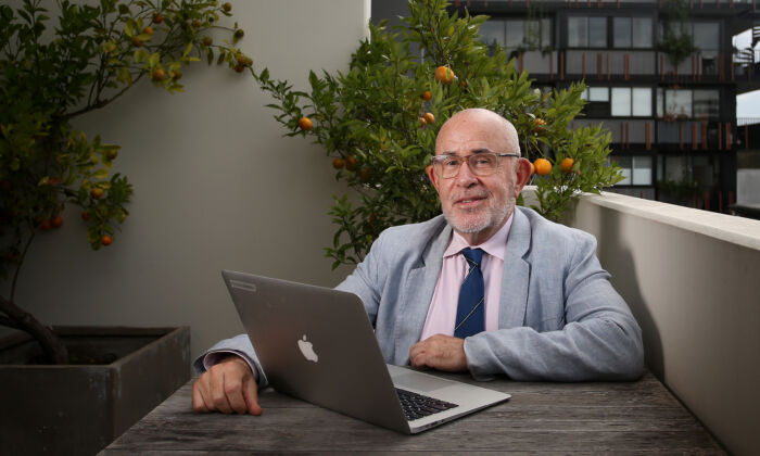 Mark Halsted, a teacher of 38 years, isolates at his home and teaching his class online, April 29, 2020 in Sydney, Australia.  (Lisa Maree Williams/Getty Images)