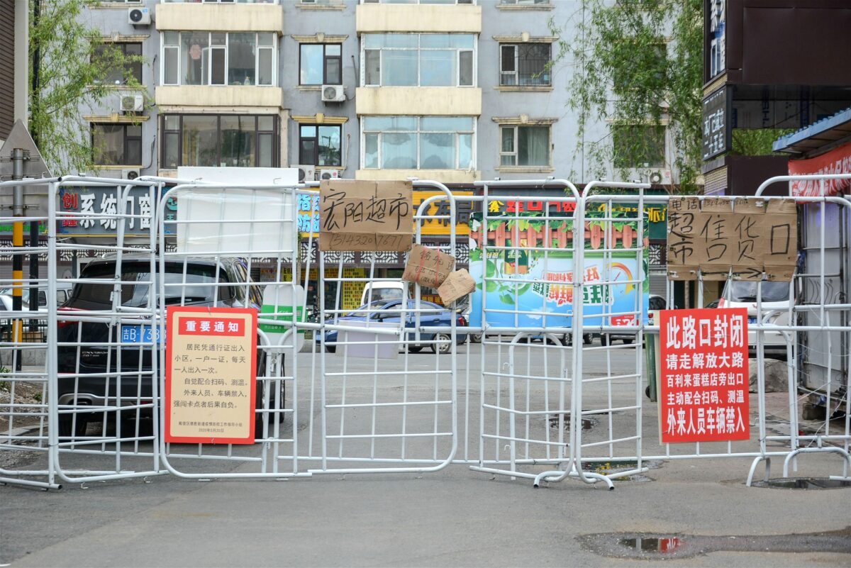Barriers separate a residential compound in Jilin