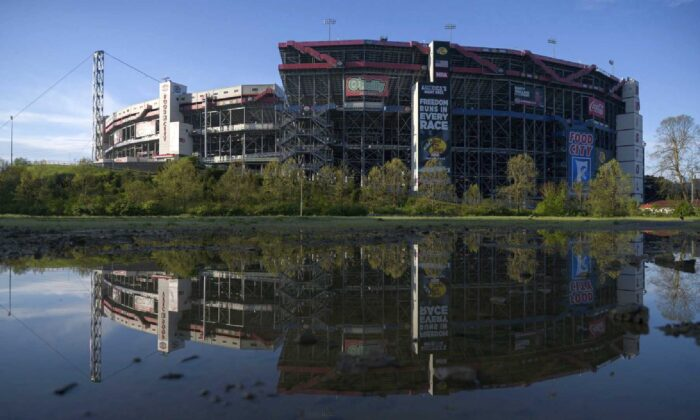 The Bristol Motor Speedway is reflected in a puddle at the camping site on May 2. (Michael Rayne Swensen)