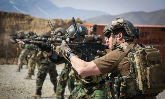 U.S. Special Forces soldiers attached to Combined Joint Special Operations Task Force-Afghanistan, practice combat marksmanship skills training on a range, near Kabul province, Afghanistan, on Feb. 24, 2014.(U.S. Army photo by Spc. Connor Mendez/Released)