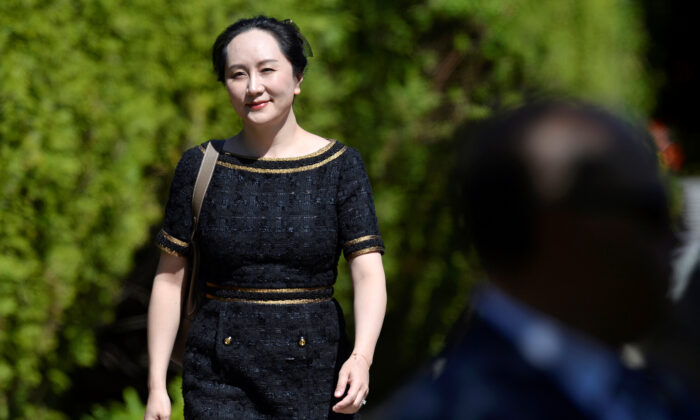 Huawei Technologies Chief Financial Officer Meng Wanzhou leaves her home to attend a court hearing in Vancouver, May 27, 2020. (Jennifer Gauthier/Reuters)