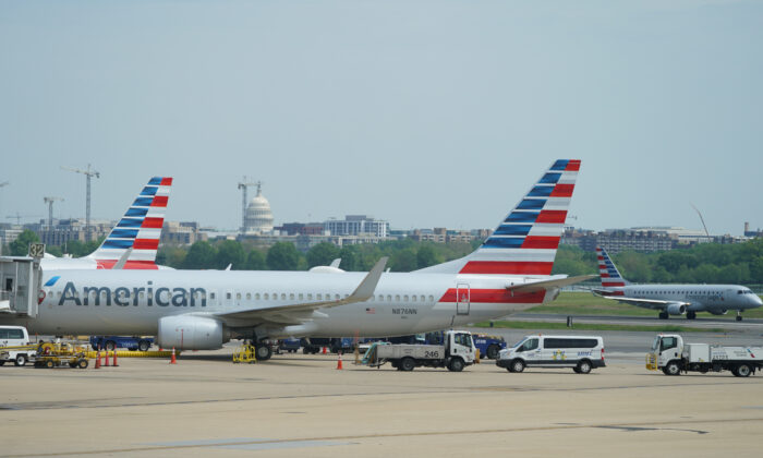 An American Airlines Boeing 737 jet sits at a gate at Washington's Reagan National airport with the U.S. Capitol building in the background, in Washington on April 29, 2020. (Kevin Lamarque/Reuters)