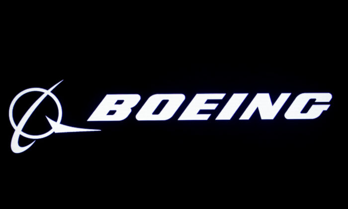 FILE PHOTO: The Boeing logo is displayed on a screen, at the New York Stock Exchange (NYSE) in New York, U.S., August 7, 2019. REUTERS/Brendan McDermid/File Photo