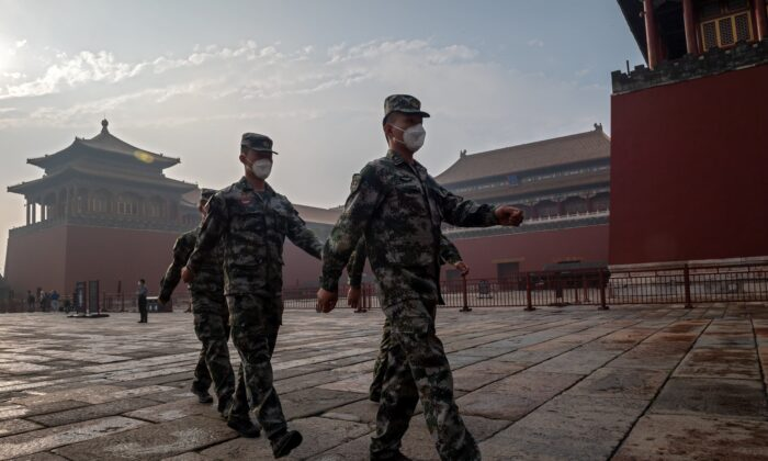 China's People's Liberation Army soldiers march next to the entrance to the Forbidden City during the opening ceremony of the Chinese People's Political Consultative Conference in Beijing on May 21, 2020. A report analyzed the dependency of five democratic countries on China and recommended decoupling from the increasingly belligerent Asian nation. (Nicolas Asfouri / AFP via Getty Images)