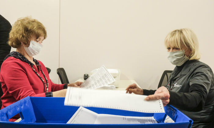 Employees and volunteers of the Franklin County Board of Elections sort through and de-stub both mail-in ballots and provisional ballots in Columbus, Ohio, on April 28, 2020.   (Matthew Hatcher/Getty Images)