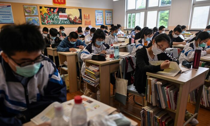 Students wearing face masks are seen in their classroom during a government organised media tour at Shanghai High School after it reopened in Shanghai, China on May 7, 2020. (HECTOR RETAMAL/AFP via Getty Images)