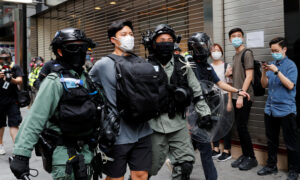 Hong Kong Police Arrest 300 as Thousands Protest