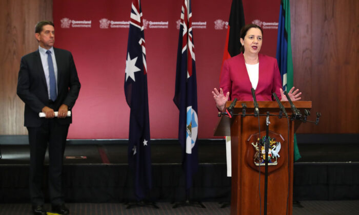 Queensland Premier Annastacia Palaszczuk (R) attends a press conference at parliament house as Minister Cameron Dick looks on, on March 25, 2020 in Brisbane, Australia. (Jono Searle/Getty Images)