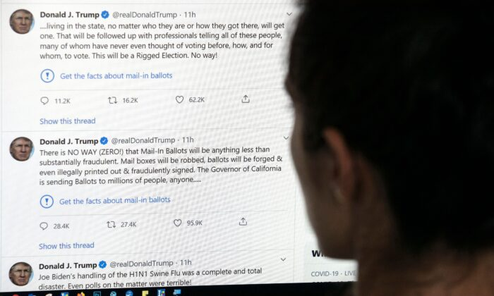 An editor in Los Angeles looks at the official Twitter account of President Donald Trump on May 26, 2020. (AFP via Getty Images)