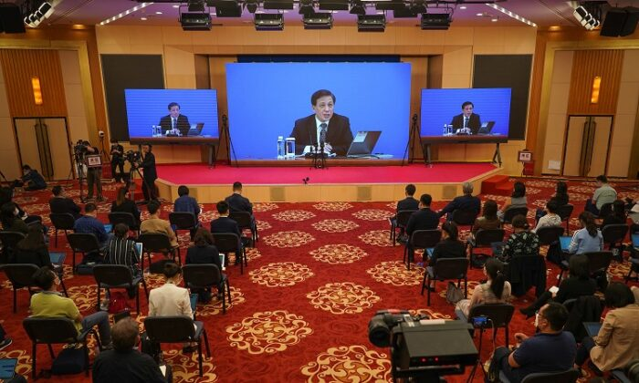 Spokesperson for the National People's Congress Zhang Yesui, located at the Great Hall Of The People , announces the new National Security Law during a video press conference in Beijing on May 21, 2020. (Andrea Verdelli/Getty Images)