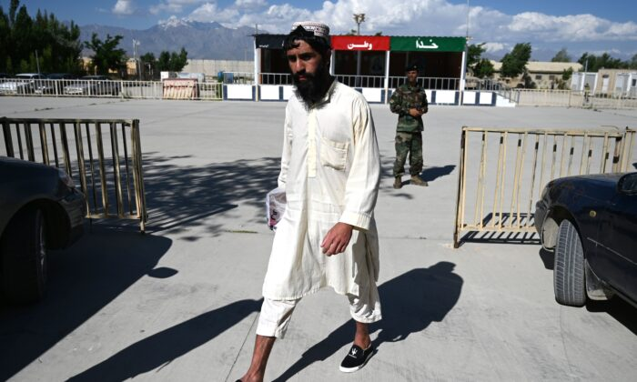 A Taliban prisoner walks during his release from the Bagram prison, next to the US military base in Bagram, some 50 km north of Kabul on May 26, 2020. (Wakil Kohsar/AFP via Getty Images)