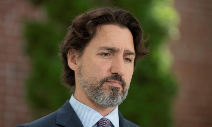 Prime Minister Justin Trudeau is asked a question on the military reports on seniors residences during a news conference outside Rideau Cottage in Ottawa, May 27, 2020. (Adrian Wyld/The Canadian Press)