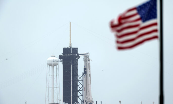 The SpaceX Falcon 9, with the Crew Dragon spacecraft on top of the rocket, sits on Launch Pad 39-A at Kennedy Space Center, Fla., on May 25, 2020. (David J. Phillip/AP Photo)