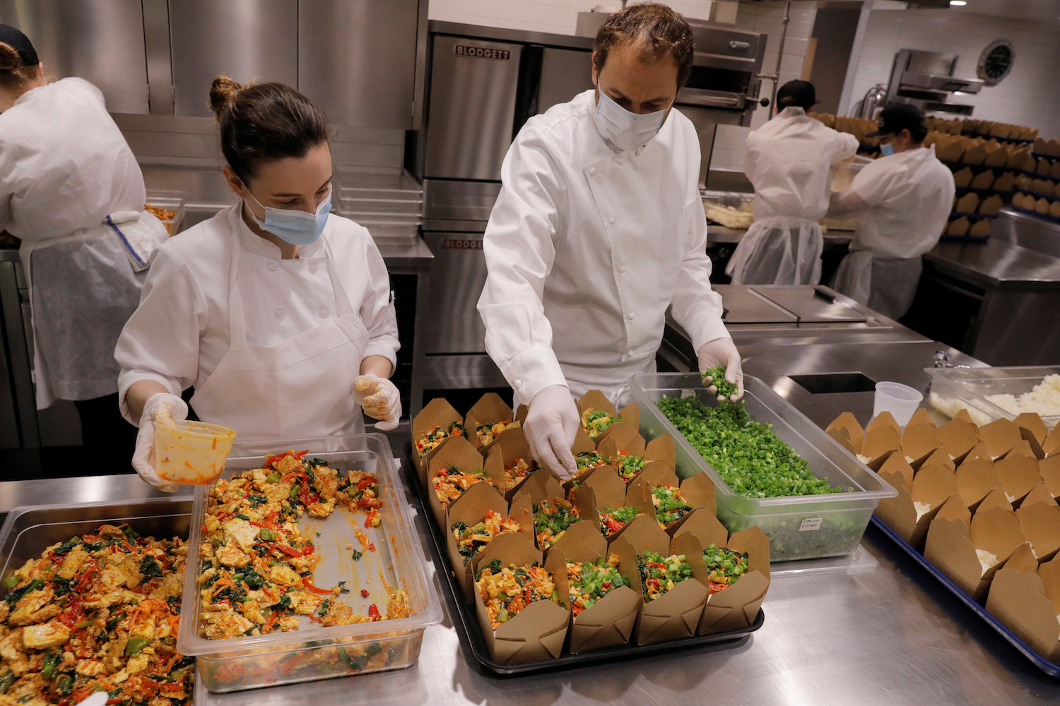 daniel humm and staff prepare food donation boxes in the kitchen of eleven madison park