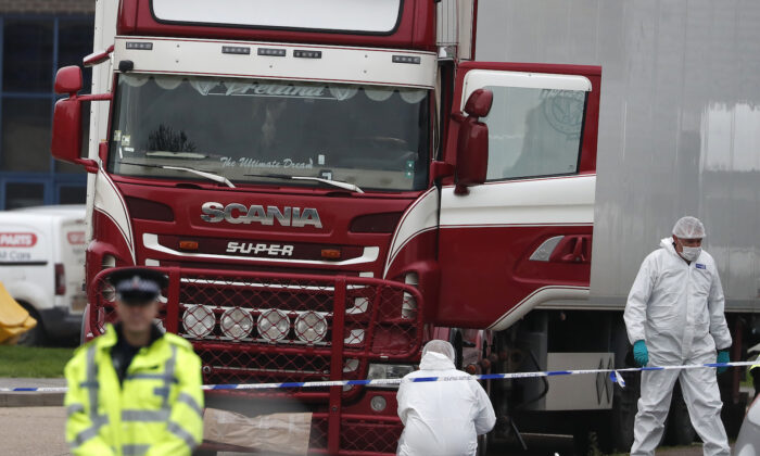 Forensic police officers attend the scene after a truck was found to contain a large number of dead bodies, in Grays, England, on Oct. 23, 2019. (Alastair Grant/AP/ file)