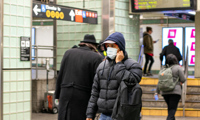 A man  wears a mask in the Times Square subway station, New York, N.Y., on March 11, 2020. (Chung I Ho/The Epoch Times)