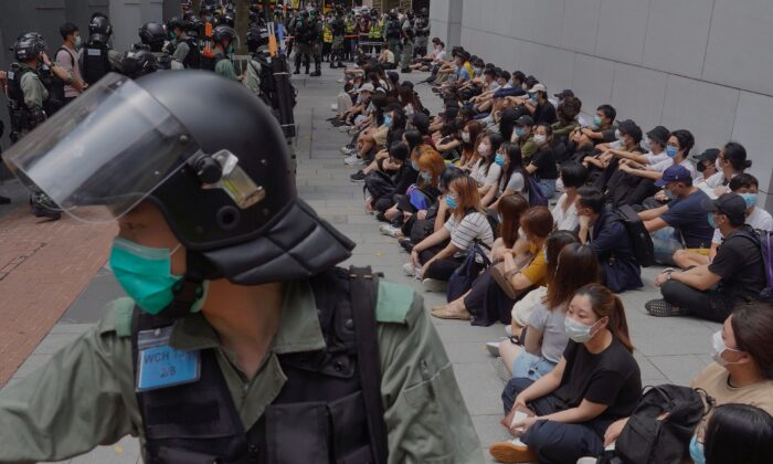 Riot police guard detained pro-democracy protesters in the Causeway Bay district of Hong Kong on May 27, 2020. (AP Photo/Vincent Yu)