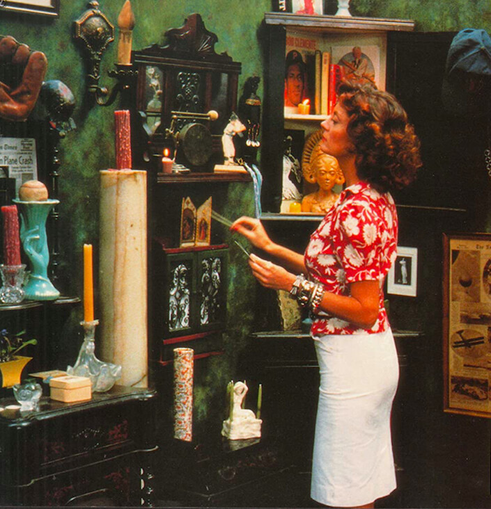 """woman in white skirt lights candles in """"Bull Durham"""""""
