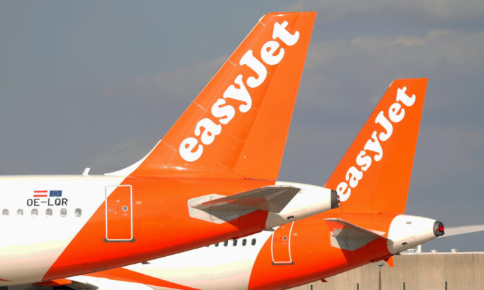 EasyJet airplanes sit on the tarmac at Charles de Gaulle airport in Roissy-en-France in Paris, France, on May 25, 2020. (Charles Platiau/Reuters)