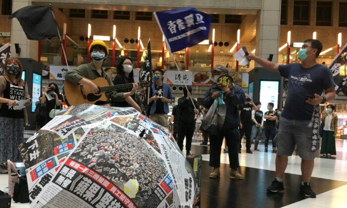Protesters holding banners in support of Hong Kong pro-democracy demonstrators attend a rally against the Chinese regime's newly announced national security legislation for Hong Kong, at Taipei main train station on May 23, 2020. (Ben Blanchard/Reuters)