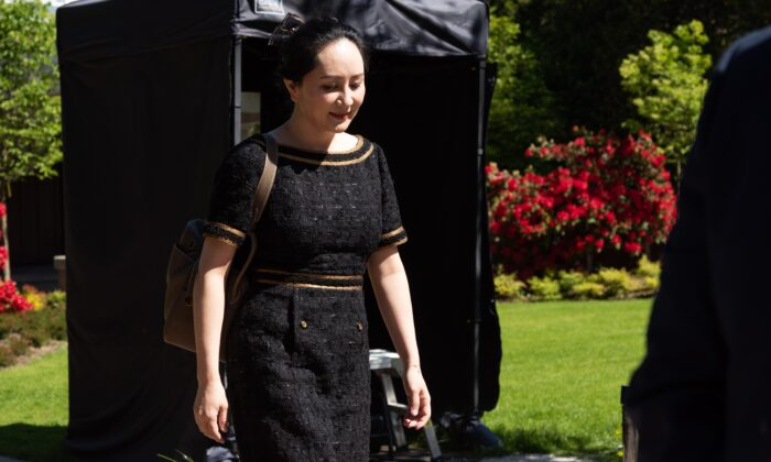 Huawei chief financial officer Meng Wanzhou walks outside her home to go to B.C. Supreme Court in Vancouver on May 27, 2020. (Jerry Wu/The Epoch Times)