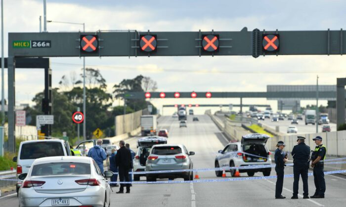Victorian Police officers attend the scene of a shooting along the Monash Freeway in Melbourne, Australia, on May 28, 2020. (AAP Image/James Ross)