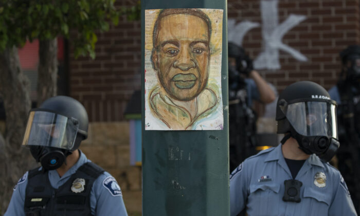 Minnesota police stand outside the department's 3rd Precinct in Minneapolis on May 27, 2020. (Carlos Gonzalez/Star Tribune/AP)