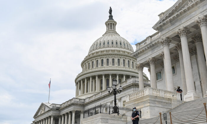Police officers wearing masks guard the U.S. Capitol building in Washington on May 14, 2020. (Erin Scott/File Photo/Reuters)