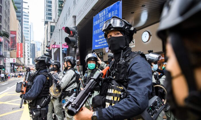 Riot police take part in a crowd dispersal operation in the Central district of Hong Kong on May 27, 2020. (Anthony Wallace/AFP via Getty Images)
