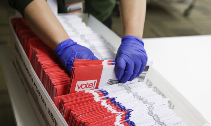 Election workers sort vote-by-mail ballots for the presidential primary at King County Elections in Renton, Washington, on March 10, 2020. (Jason Redmond/AFP via Getty Images)