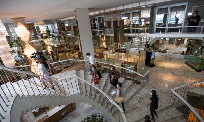 """Journalists visit the Melia Palma Marina Hotel to be shown the """"Stay Safe with Melia"""" program, ahead of the public re-opening of the hotel in Palma de Mallorca, on May 27, 2020. (JAIME REINA/AFP via Getty Images)"""