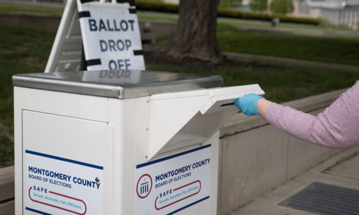 An Ohio voter drops off their ballot at the Board of Elections in Dayton, Ohio, on April 28, 2020. (Megan Jelinger/AFP via Getty Images)