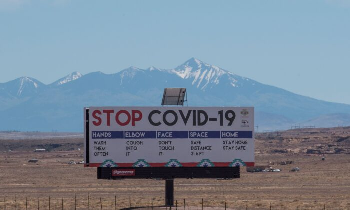 A sign warns against COVID-19 near Tuba City, Ariz., on May 24, 2020. (Mark Ralston/AFP/Getty Images)