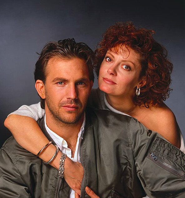 """man in bomber jacket and woman in white shirt in """"Bull Durham"""""""