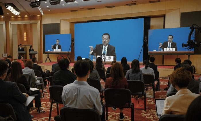 Chinese Premier Li Keqiang speaks at the video press conference from The Great Hall Of The People after the closing of the rubber-stamp legislative annual meeting in Beijing, China on May 28, 2020. (Andrea Verdelli/Getty Images)