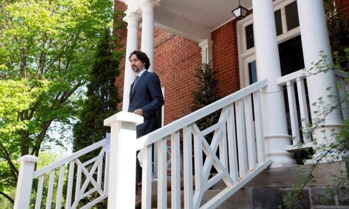 Prime Minister Justin Trudeau steps out of Rideau Cottage for a news conference in Ottawa, on May 27, 2020. (The Canadian Press/Adrian Wyld)