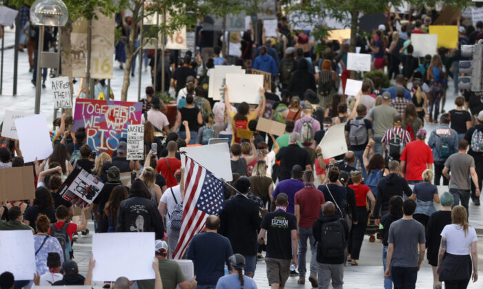 Protesters walk down the 16th Street mall in Denver, Colorado, during a protest over the death of George Floyd, a handcuffed black man who died in police custody in Minneapolis, on May 28, 2020. (AP Photo/David Zalubowski)