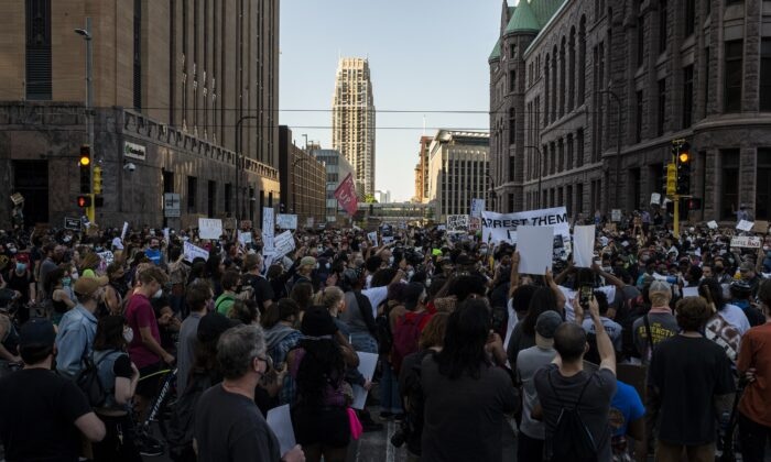 Protesters march through the street in downtown Minneapolis, Minn. on May 28, 2020. (Stephen Maturen/Getty Images)