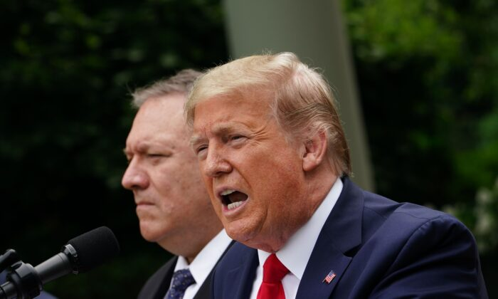 President Donald Trump, with Secretary of State Mike Pompeo, holds a press conference on China in the Rose Garden of the White House in Washington, on May 29, 2020. (Mandel Ngan/AFP via Getty Images)